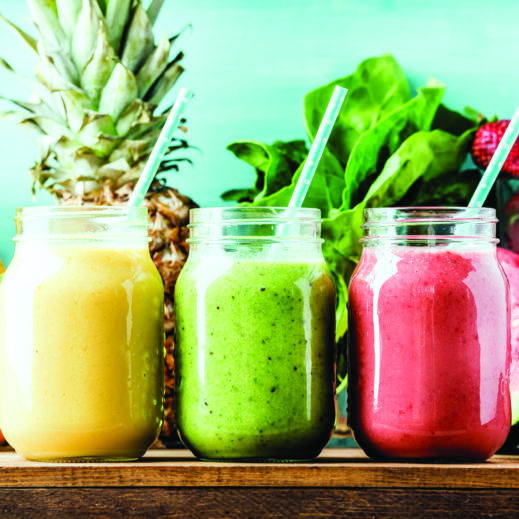 56468579 - freshly blended fruit smoothies of various colors and tastes  in glass jars. yellow, red, green. turquoise blue background